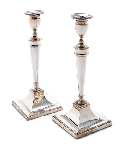 A pair of George III silver candlesticks Maker's mark of Thomas Daniell, London, overstriking that of another, possiby George Ashforth, Ellis Hawksworth and Best, Sheffield 1784  (2)