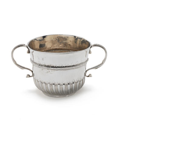 A William III two-handled silver  porringer by William Andrews, London 1699