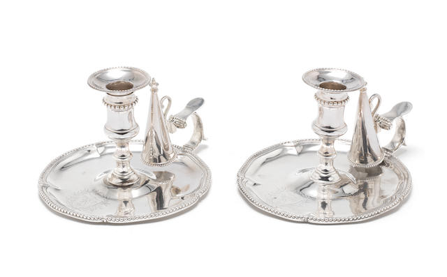 A pair of George III silver chambersticks by John Carter, London 1772  (2)