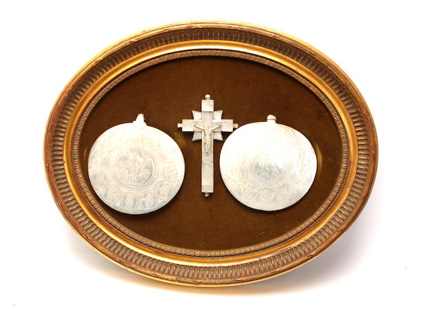 Two carved mother of pearl shell-shaped dishes
