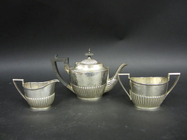 An Edwardian silver three piece bachelor's tea service Walker & Hall Sheffield, 1905  (3)