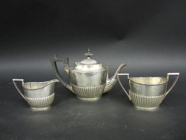 An Edwardian silver three piece bachelor's tea service Walker & Hall Sheffield, 1905  (3)