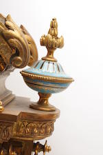 A French ormolu mounted and Sèvres pattern porcelain clock garniture