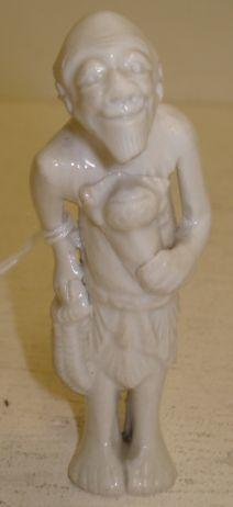 A Japanese blanc de chine netsuke, in the form of an elderly man, 8cm.