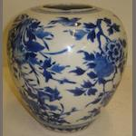 A Chinese blue and white baluster jar, painted with birds amongst flowering branches, neck reduced, 17cm.