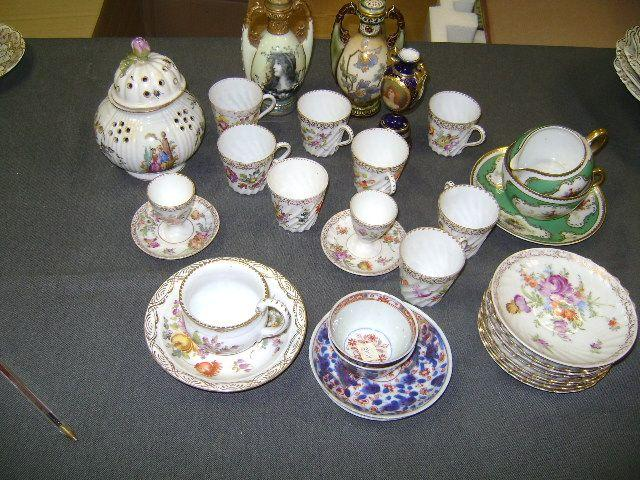 A mixed lot of ceramics, to include a Meissen cup and saucer, cancelled marks, a pair of Chinese teabowls and saucers with clobbered decoration and assorted continental porcelain including a Dresden part coffee service and Austrian vases.
