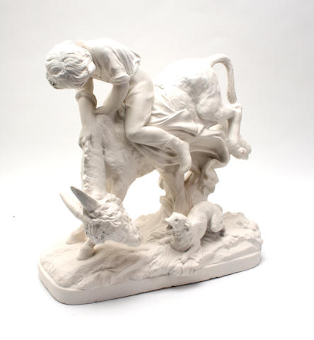 A plaster group depicting a boy riding a donkey