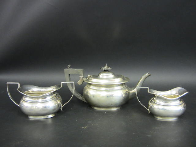 A silver three piece tea set Birmingham 1925 - 1928
