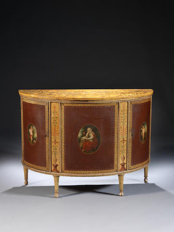 A George III japanned, polychrome decorated and parcel gilt demi-lune commodeattributed to George Brookshaw, the painted panels after Angelica Kauffmann