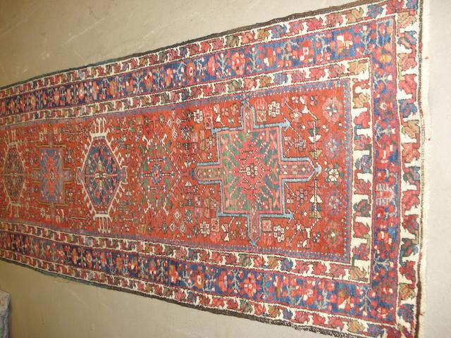 A Heriz runner, North West Persia, 473cm x 102cm