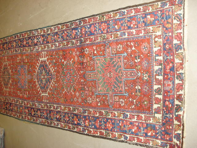 A Heriz runner, North West Persia, 473cm x 102cm