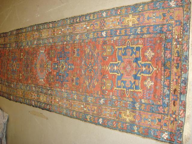A Heriz runner, North West Persia, 330cm x 95cm