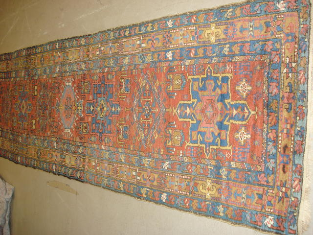 A Heriz runner, North West Persia, 330cm x 95cm