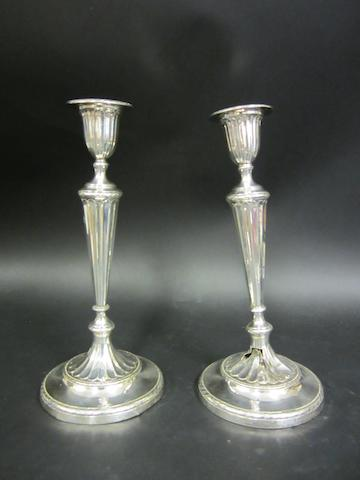 A late Victorian pair of silver candlesticks Sheffield 1894