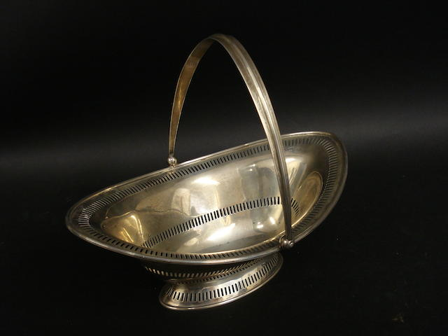 A silver swing handle basket by Barker Bros., Chester 1922
