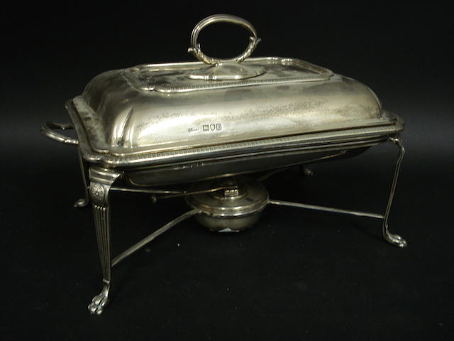 An Edwardian silver rectangular two handled entree dish, with liner, on stand by Harrods Stores Ltd., London 1907/09