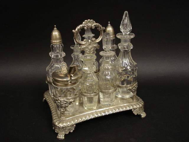 A George IV silver and glass eight bottle condiment stand by Joseph Angel, London 1822