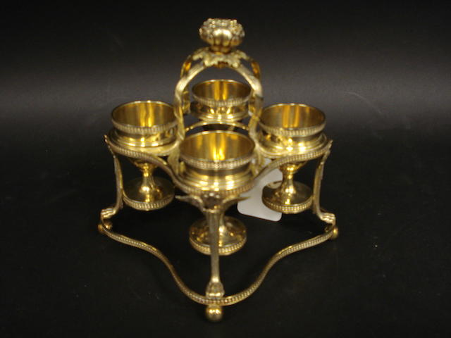 A George III silver gilt 4 division egg cruet and stand