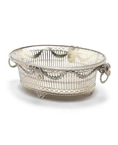 MILITARY INTEREST: A Victorian Britannia standard silver-gilt two-handled basket by Carrington & Co, London 1899