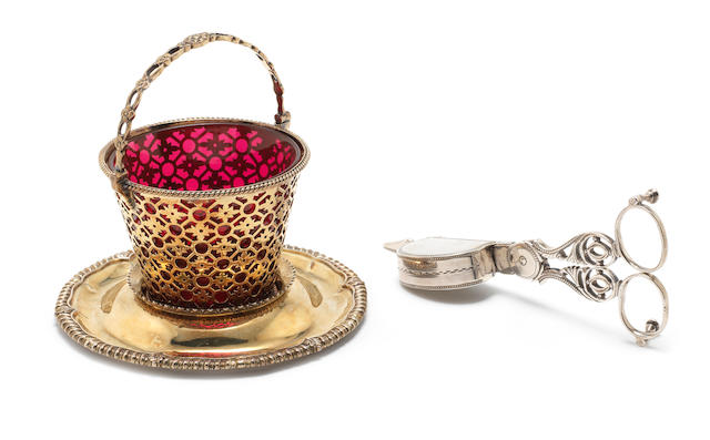 A George III silver-gilt swing-handled basket with matched stand  (5)
