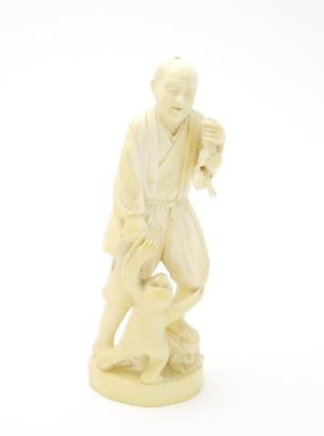 An ivory okimono of a monkey trainer SIGND Meiji