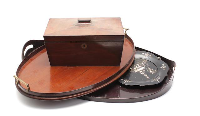 An Edwardian mahogany oval tray