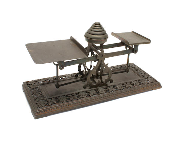 A set of brass postal scales