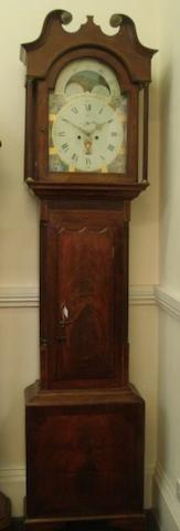 "John Parker Pontefract:  a 19th Century inlaid mahogany longcase clock, the 14"" painted dial with seconds subsidiary and spandrels representing the seasons, the arch with moonphase, 8 day movement striking on a bell, two weights, pendulum and key, 242cm high."