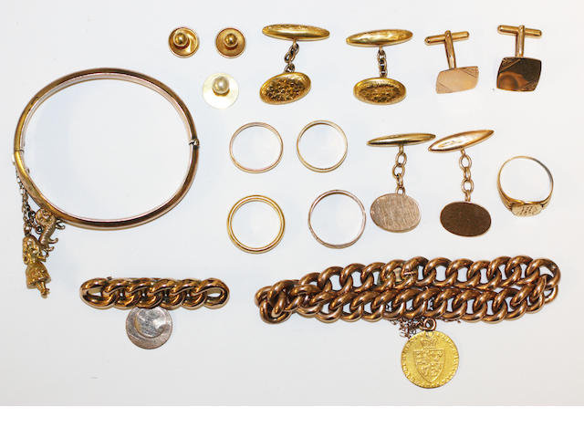 A collection of yellow precious metal jewellery,
