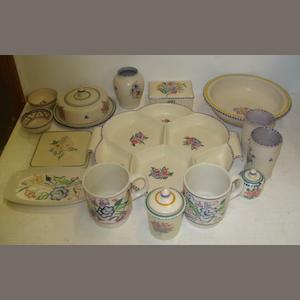 A collection of Carter Stabler Adams Poole to include, a bowl, circa 1920, interior centrally decorated with a stylised floral sprig, 21cm, circular butter dish and cover, 17cm, pair of cylindrical spill vases, impressed marks, together with other items of Poole Pottery to include a baluster posy vase, in the harebell pattern, 9.5cm, two small bowls, cigarette box, six division hor d'oveures dish, teapot stand, mustard pot, preserve jar, two traditional pattern mugs and a dish. (15)