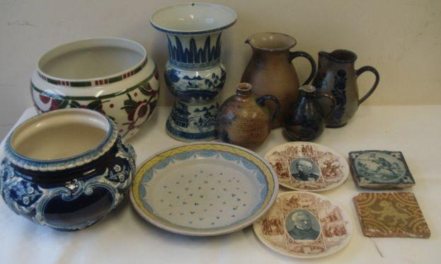 A 19th Century French Faience dish, with swag painted border and dotted decoration, a Delft tile painted with a huntsman, an encaustic tile, four salt glazed stoneware vessels with combed and coloured decoration, jardinieres and a Chinese blue and white vase.