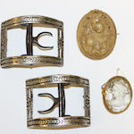 Two cameo brooches and two buckles, comprising a lava cameo brooch, carved to depict a bacchante in profile, the mount stamped '9ct', a paste cameo brooch, carved to depict a classical female portrait in profile, and two buckles, first brooch length 4.9cm. (4)
