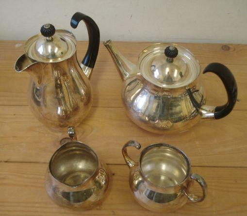 Eric Clements for Mappin & Webb:  a post war silver plated four piece tea set, with projecting handles and black plastic finial.