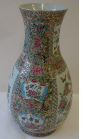 A late 19th Century Chinese Canton famille rose decorated baluster vase, with panels of birds within brocade ground, 42cm, drilled for a lamp and two polished hardwood stands. (3)