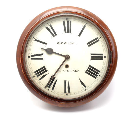 An early 20th century mixed wood wall clock Inscribed R.F. Bear, Cheltenham.