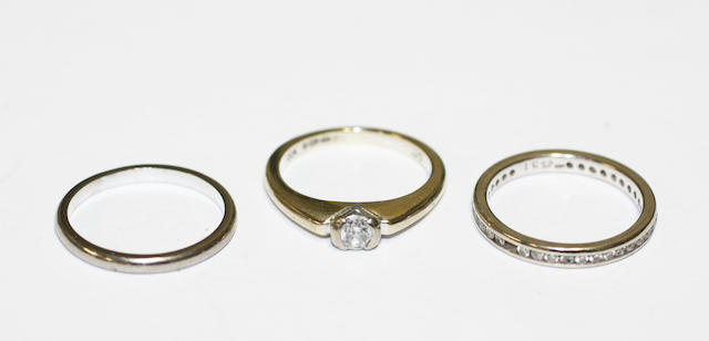Two diamond set rings and a band ring,