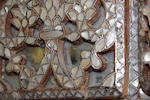 A middle eastern mother of pearl and bone inlaid wall mirror