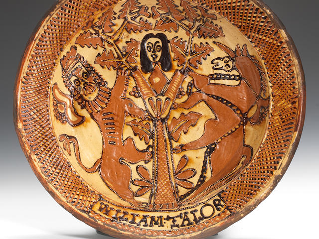 A Staffordshire slipware dish by William Talor, circa 1680-85