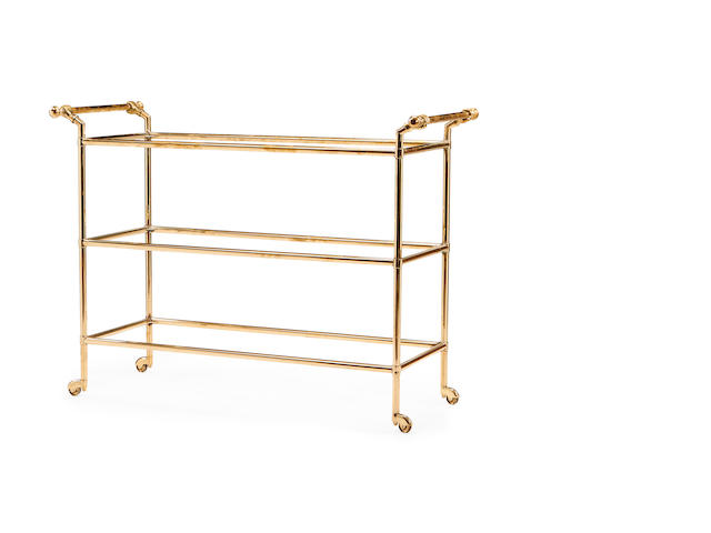 A brass three-tier trolley