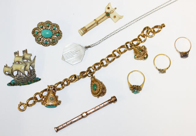 A small collection of jewellery including a fancy curb-link chain bracelet, stamped '750', suspending three charms, a 9ct gold mounted turquoise and seed pearl whorl brooch, a 9ct gold retractable pencil, three rings, etc.