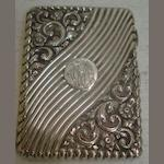 A Victorian silver visiting card case, Birmingham 1890, rectangular, embossed with flowers, leaf scrolls and curved lobes and flutes around cartouches, 10cm, 3ozs.