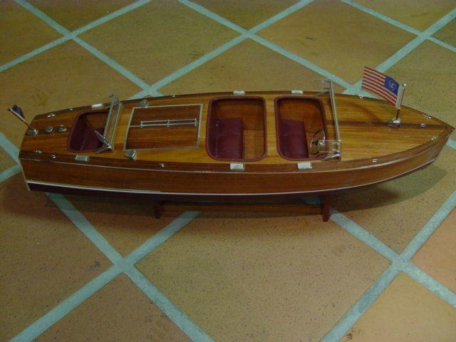 A 1:10 scale handbuilt model of a Chris Craft Triple Cockpit Gentleman's runabout,