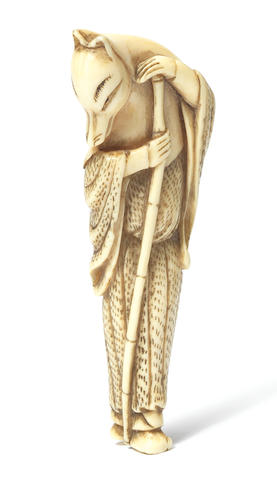 An ivory netsuke of a fox priest Late 18th century