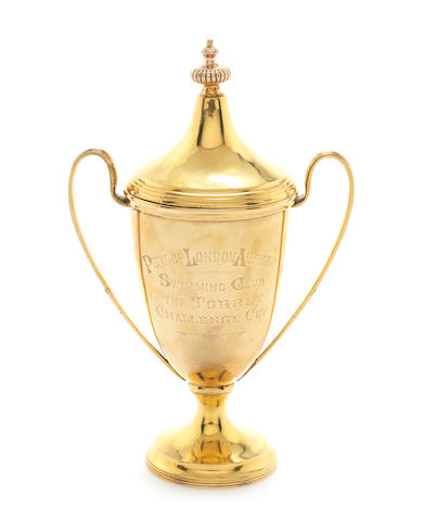 An Edwardian 9 carat gold two-handle trophy cup by Dobson & Dobson, London 1908