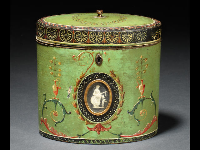 A George III polychrome decorated oval papier mâché tea caddy attributed to Henry Clay, the decoration in the manner of Robert Adam, the jasperware medallions attributed to Wedgwood