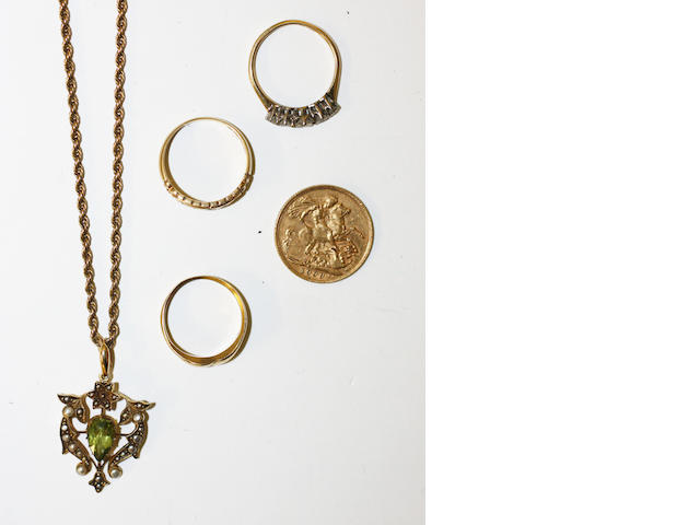 A small collection of jewellery items, including an Edward VII sovereign, 1909, an Edwardian peridot and seed pearl scroll pendant, stamped '15ct', on later uniform ropetwist chain, a five stone diamond ring, an 18ct gold emerald and diamond band ring and a further band ring.