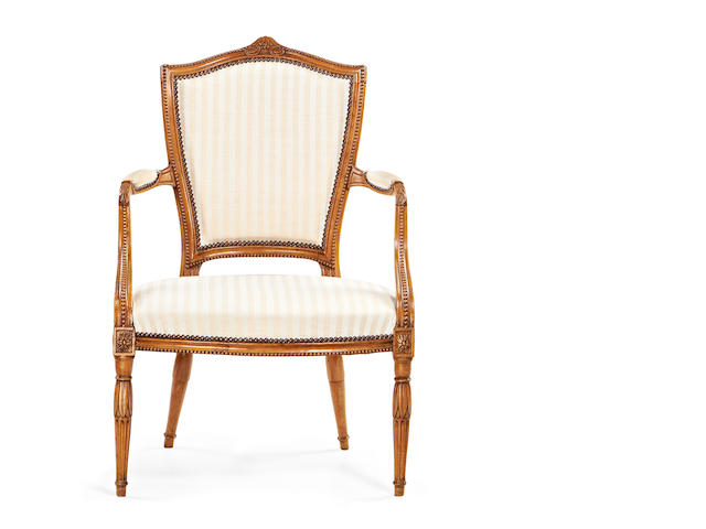 A George III stained beech armchair in the Louis XVI style