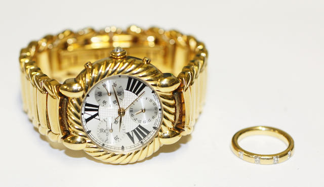 An 18ct gold five stone diamond ring and a plated wristwatch,