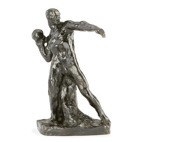 An early 20th century bronze figure of a shot-putter