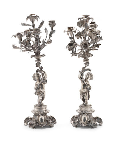 A pair of electroplated candelabra unmarked